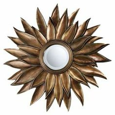 Add an eye-catching touch to your living room or entryway with this lovely wall decor, showcasing a sunburst motif and mirrored accent.