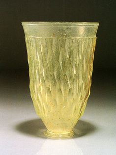 https://flic.kr/p/857jh5 | Roman Cut Glass Beaker | Cut glass, 1st-2nd century B.C.E., from the Eastern Mediterranean  H. 13.1 cm.    The cut-glass technique using almost colorless translucent cast glass has already appeared in Assyria by the 8th century BC, but it did not become widespread until the Roman period. This cup was blown from yellowish green translucent glass which was then formed in a mold and later cut with decorations. The long narrow hexagonal cuts are ranged in three and a…