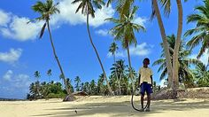 Kid at Bweni Village. Photo by Mafia, Scenery, Street View, Kid, Island, Landscape, Beach, People, Block Island