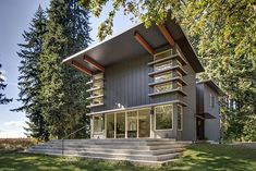 """This unique two story Stillwater Dwellings prefab home was designed with our signature """"eyebrow"""" window which brings light and space to the main living area. Metal Homes Floor Plans, Metal Building Homes Cost, Home Building Kits, Building Exterior, House Floor Plans, Building A House, Modern Prefab Homes, Prefabricated Houses, Stillwater Dwellings"""
