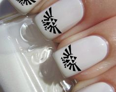Black and white essie legend of Zelda triforce nail art