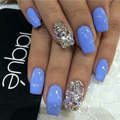 Light blue nails with one finger on each hand having sparkles