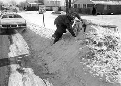 Columbus, January 29, 1977:  A man begins the arduous task of uncovering a car buried by a snow drift.