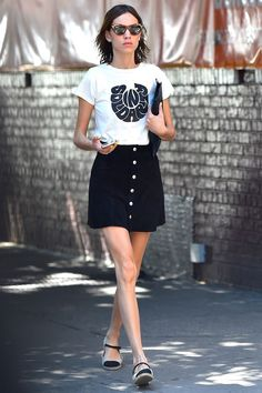 Alexa Chung in New York teamed a slogan tee by The Deep End Club with a skirt from her collection with AG Jeans.