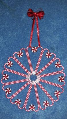 20 Best Ideas For Adorable Christmas Candy Cane Crafts For Kids Reusable candy cane and peppermint wreath made by plastic ornaments and mints. Christmas Candy Crafts, Candy Cane Crafts, Candy Cane Wreath, Dollar Store Christmas, Homemade Christmas, Christmas Art, Holiday Crafts, Christmas Wreaths, Christmas Ornaments