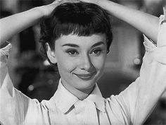 Audrey loves her new short haircut (gif) - delightful scene from Roman Holiday.