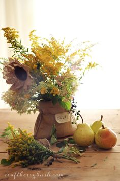Love these burlap sunflowers in a simple burlap bag.  Beautiful vignette! Tutorial for flowers in post.
