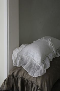 Lovely linens against a perfect gray wall