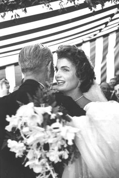 http://en.wikipedia.org/wiki/Jacqueline_Kennedy_Onassis Former US Amb. to Great Britain Joseph Kennedy, dancing with son John F. Kennedy's bride, Jacqueline Bouvier Kennedy, at their wedding reception held at her mother's home. (Photo by Lisa Larsen//Time Life Pictures/Getty Images).    http://en.wikipedia.org/wiki/Wedding_dress_of_Jacqueline_Bouvier
