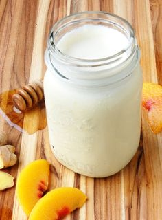 ginger peach smoothie for wellness - this sweet and spicy smoothie helps with pain relief, nausea and is anti-inflammatory. contains peach, ginger, honey, coconut milk. Peach Smoothie Recipes, Yummy Smoothies, Juice Smoothie, Smoothie Drinks, Making Smoothies, Detox Drinks, Ginger Peach, Fresh Ginger, Ginger Juice