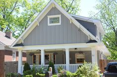 colors:  body of house: SW7018 - dovetail  dormers: SW7019 - gauntlet gray  trim: SW7008 - alabaster  accents: SW6664 - marigold
