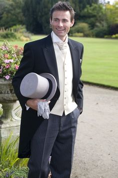 Traditional Tailcoat Wedding Suit - Inspiration for groomsman Mickey and his outfit in Caught on Camera.