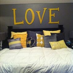 I love the dark wall with lighter pillows, with yellow, with light grey bedding. sooooo cute.