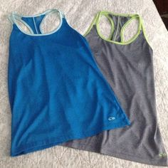 Champion C9 workout tops size small These are from Target. Like new condition. One is blue and light blue. The other is dark gray and lime green. Both size small Champion Tops Tank Tops