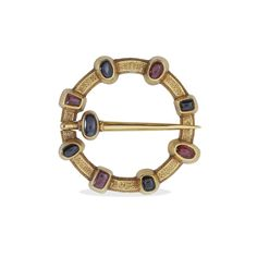Beautiful workmanship and sentiment. Medieval, 13th C, from England. Gold brooch with rubies and sapphires. The reverse side has inscription (in abbreviated French) 'io sui ici en liu dami amo' ('I am here in place of a friend love'), indicating that the brooch is likely to have been an expensive love token.