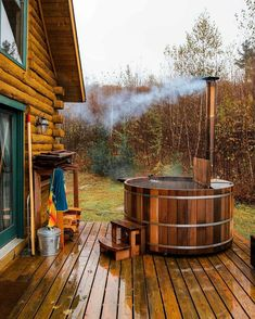 A hot tub heated by a wood burning stove. A Frame Cabin, A Frame House, Cabin Homes, Log Homes, Rustic Hot Tubs, Ideas Cabaña, Cabin Decks, Log Cabins, Cozy Cabin