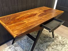 """Original Graham and Green """"Odyssey Writing Desk""""   The Odyssey Writing Desk is based on an Italian 1940's design. Made of dark oak stained mango wood and complete with a single central storage drawer.  Dimensions: H76 x W130 x D60cm Material: Made from beautiful sheesham wood. Colour: dark brown"""