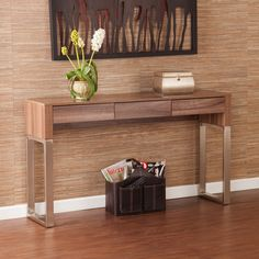 Providing both storage and display space, the Upton Home Agusta console/sofa table makes a great addition to your family or living room. This table's three convenient drawers, compact feel, and unique design works well with transitional or modern décor.