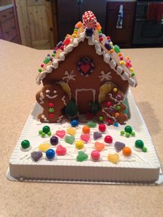 Gingerbread house-cute!  How about little teddy bear graham crackers or animal crackers