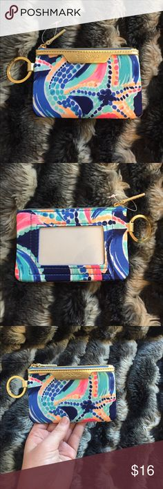Brand New Lilly Pulitzer Key ID Case Brand new, never used key id case from Lily Pulitzer with beautiful vibrant print and gold details. Lilly Pulitzer Accessories Key & Card Holders