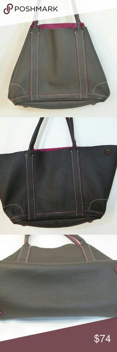 """Borge Gaveri Uptown Tote (J. Crew) This beautiful pebbled black leather Borge Gaveri Uptown Tote, is part of the J.Crew Collection, and is contrasted with fuchsia edgings and a matching suede interior.  Snaps on the outer sides, allow for bag to be opened up. Metal feet at the bottom, also edged in fuchsia.  Strap drop, approx. 8.5"""", open bag measures approx 18""""L and closes to 12.5"""", 10.5""""H x 6""""W.  Exterior is in wonderful condition, interior suede has some visible signs of shedding,  and…"""