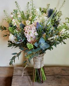 My bouquet: something with this shape/look, but some baby's breath and blue/white color scheme. I like thistle and cornflower.