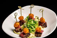 "Grilled Filet Mignon. Truffled ""tater tots"", frisee, stilton blue cheese fondue."
