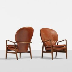 Arne Vodder Attributed; Teak and Leather Lounge Chairs, c1950.