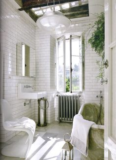 simple white and marble bathroom // skylight + window