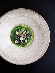 Chef Blaine Wetzel of Lummi Island's Willows Inn is responsible for this soup of wild grass broth with blackberries and dill oil.