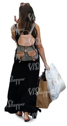 A woman in a black summer dress walking and carrying some shopping bags