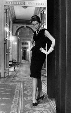 Capucine posing in dress by Givenchy in the hallway of a Rome hotel, 1962