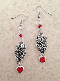 These cute owl dangle earrings are silver plated fish hook earrings. These earrings include silver-plated owl charms. Also included are red seed beads and red acrylic heart charms! Owl Earrings, Fish Hook Earrings, Pearl Drop Earrings, Crystal Earrings, Bridesmaid Earrings, Bridesmaid Gifts, Fine Jewelry, Jewelry Making, Owl Jewelry