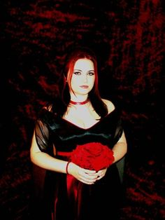 gothic bride with red wedding flowers