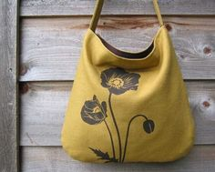 I completely adore poppies.... and yellow. :) And bags! A winning match - and this is handmade and organic to boot.