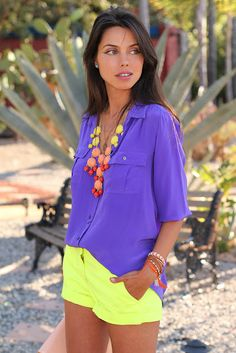 yellow shorts + bright periwinkle top + chunky colorful necklace