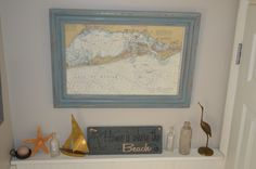 The frame is a redo from a thrift shop find, the map was buried in the back of a closet at an estate sale. I display with vintage glass and brass.