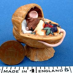 Mouse asleep in walnut shell bed by Blue Kitty Miniatures, via Flickr