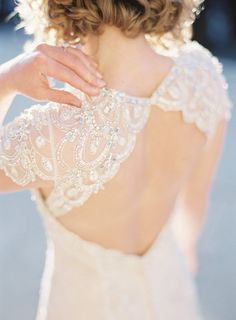Backless beaded wedding dress: Photography : Sposto Photography Read More on SMP: http://www.stylemepretty.com/california-weddings/2016/02/17/berry-hued-wedding-inspiration-at-ebell-club-of-long-beach/