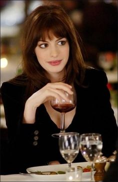 Anne Hathaway in The Devil Wears Prada ~eyemakeup (She looks so much better than she does in the paler dress below ).