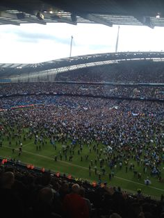 Pitch invasion when the final whistle went at the Etihad and Manchester City were crowned Premier League champions 2013/14