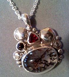 Sterling Silver pendant set with Tourmilated Quartz, Onyx & Rhodalite Granet by Richelle Leigh Collection.