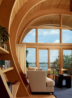 living area of Organic Guest House with Curved Glulam Pine Beams