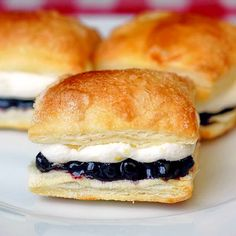Blueberry Lemon Mini Puff Pastries -A terrific hand-held little dessert that's ideal for parties or even picnics. People always seem so impressed by them even though the frozen puff pastry makes them so easy to prepare.
