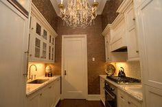 Chandelier in the kitchen...why not!  Love the paint color too!