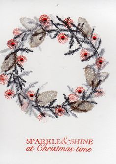 wreath made using card-io stamps.  One branch, 1 fir cone and 1 circle with a few gems