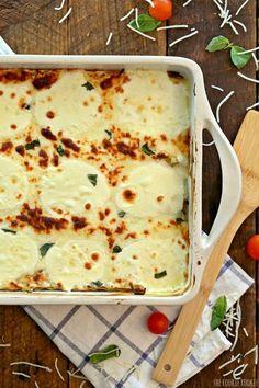 Creamy White Chicken Caprese Lasagna stuffed with mozzarella cream cheese…