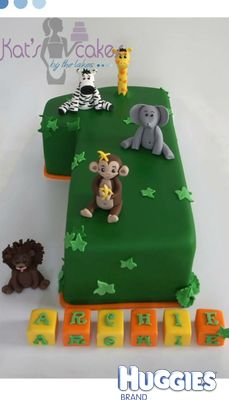 Mud cake in the shape of a number 1! Fondant icing with the jungle animal cake toppers!!