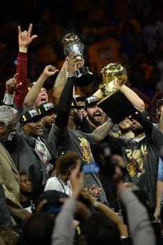 The Cleveland Cavaliers celebrate with the Larry O'Brien NBA Championship Trophy after defeating the Golden State Warriors in Game Seven of the 2016...