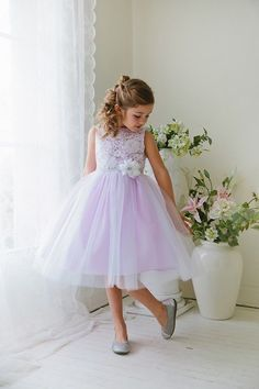 Champagne taffeta and organza flower girl dress with lace bodice, diamante lace waistband and layered skirt.